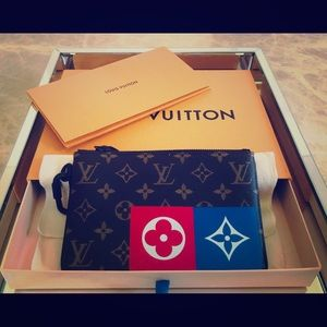 Louis Vuitton pouch with receipt